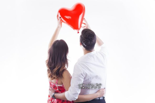 Young people in love holding a heart balloon.